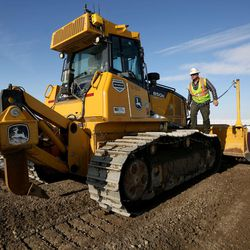 Blaine Cozzens helps build a temporary road to access the new prison site in Salt Lake City on Wednesday, Dec. 28, 2016.