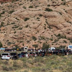 """A long line of cars waits to get into Arches National Park, just outside Moab, on Friday, Sept. 9, 2016. Each month this year, visitation at Arches was 10 percent higher than 2015, but September numbers skyrocketed to 20 percent higher than last year, according to Jodi Rupp, the revenue and fee business manager at Arches and Canyonlands national parks. """"We've had traffic to the highway every morning,"""" Rupp said."""