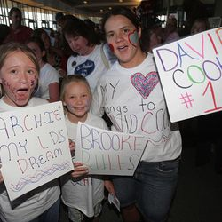 Chelsea Smith, 12, left; Cami, 9; and their mom, Tara, cheer for David Archuleta before the start of the American Idols Live concert at the E Center in West Valley on Monday night.