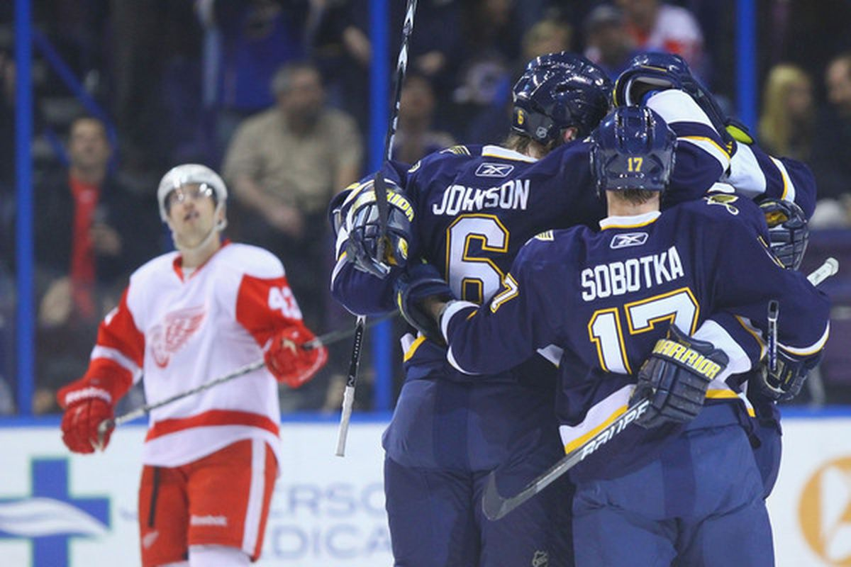 ST. LOUIS MO - DECEMBER 23: Members of St. Louis Blues celebrate a goal against the Detroit Red Wings at the Scottrade Center on December 23 2010 in St. Louis Missouri.  The Blues beat the Red Wings 4-3.  (Photo by Dilip Vishwanat/Getty Images)