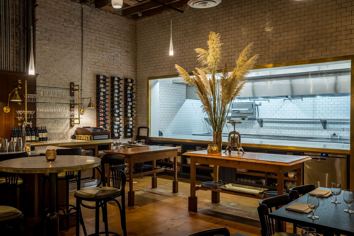 A gleaming kitchen inside of a fine dining restaurant.