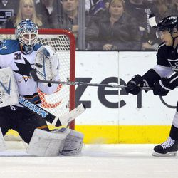 San Jose Sharks goalie Antti Niemi, left, of Finland, stops a shot as Los Angeles Kings right wing Dustin Brown tries to redirect the puck during the first period of an NHL hockey game, Thursday, April 5, 2012, in Los Angeles.