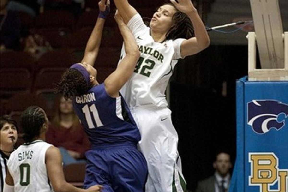 Brittney Griner smirks as she blocks a K-State shot in the Big 12 semifinals, one of seven in the game and 18 in the tournament, a new record. (Credit: Brendan Maloney-US PRESSWIRE)