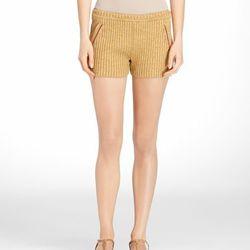"<a href=""http://www.toryburch.com/ENA-SHORT/11123203,default,pd.html?dwvar_11123203_color=716&start=27&cgid=sale"">Ena shorts</a>, $125 (were $250)"