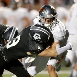 Corner Canyon's Harrison Taggart brings down Skyridge's Jeter Fenton during a high school football game at Corner Canyon in Draper on Friday, Sept. 24, 2021. Corner Canyon won 38-23.