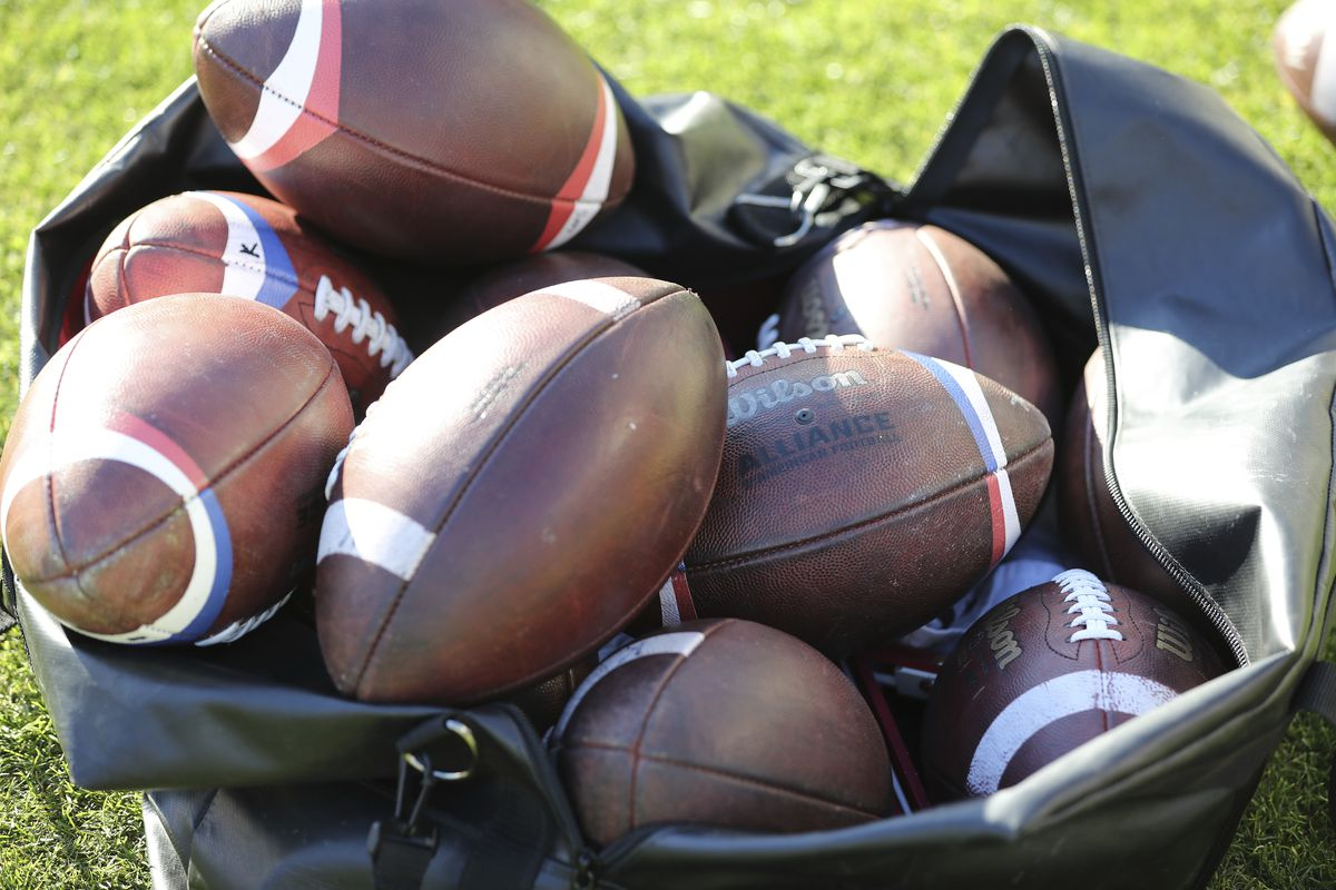 A bag of Alliance of American Football league football waits ready for usage before a San Antonio Commanders at San Diego Fleet AAF football game, Sunday, Feb. 24, 2019, at SDCCU Stadium in San Diego.