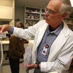 Dr. Alan Light of the Anesthesiology Department holds up one of the samples in part of discovering a way to definitively diagnose someone with chronic fatigue syndrome Friday, May 16, 2014, at University of Utah Hospital.