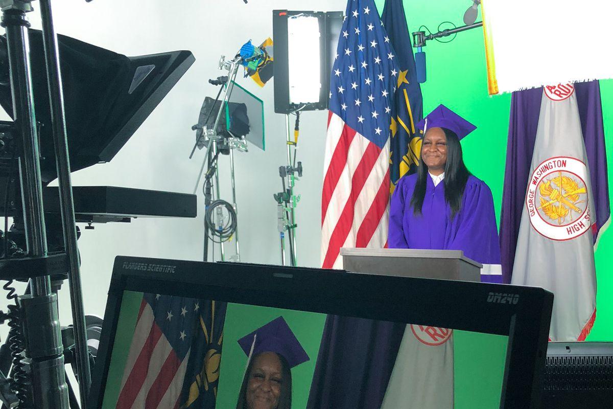 Zaria Townsend, senior class president at George Washington High School, films part of her school's virtual graduation ceremony.