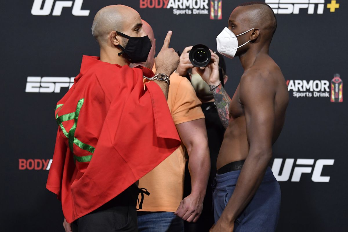 Opponents Ottman Azaitar of Germany and Khama Worthy face off during the UFC Fight Night weigh-in at UFC APEX on September 11, 2020 in Las Vegas, Nevada.