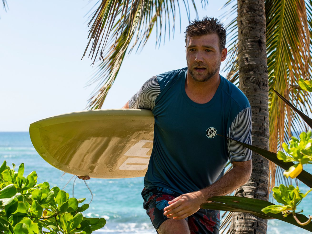 A surfer with a surfboard for IPD International.