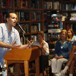 """In this June 28, 2011 photo, formerU.S. Army Captain Luis Carlos Montalvan speaks at a book signing for his book """"Until Tuesday,"""" at a book store in Coral Gables, Fla. Since serving two tours of duty, for which he received two Bronze Stars and the Purple Heart, the former Army captain has become a strong critic of the war and an advocate for better care of those who served."""