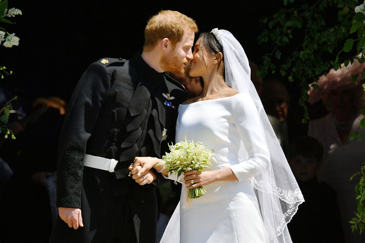 The now-married couple kisses on the steps of St. George's Chapel.