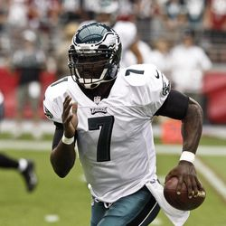 Philadelphia Eagles' Michael Vick (7) scrambles away from the Arizona Cardinals defense during the first half in an NFL football game on Sunday, Sept. 23, 2012, in Glendale, Ariz.