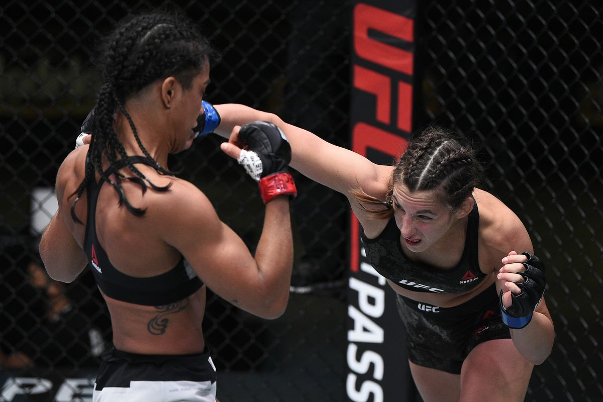 In this handout image provided by UFC, Montana De La Rosa punches Viviane Araujo of Brazil in a flyweight fight during the UFC Fight Night event at UFC APEX on September 05, 2020 in Las Vegas, Nevada.