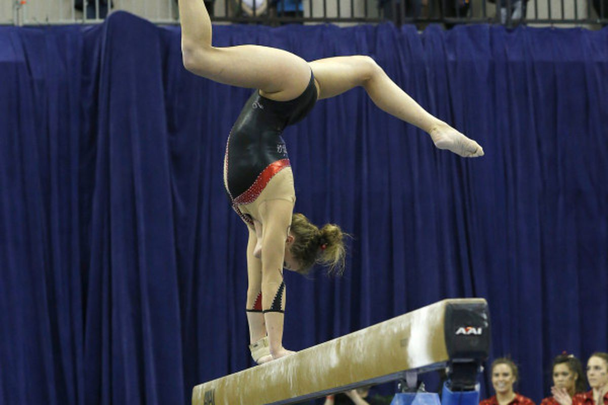Brittany Rogers, doing her signature balance beam move, which earned her a 9.90 on Friday night.