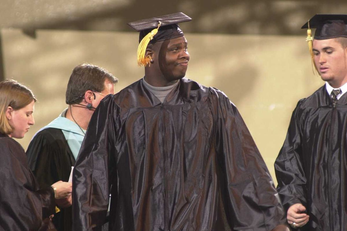 We couldn't find a picture of him playing football, but here is Anthony McKenzie getting his degree from USF.