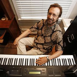 """Songwriter and musician Bobby Wood is shown in his Nashville, Tenn., office Thursday, Aug. 13, 2009. Wood was one of the studio musicians who recorded with Elvis Presley at American Sound Studio in Nashville. Among those recordings was Presley's last No. 1 hit, """"Suspicious Minds."""""""
