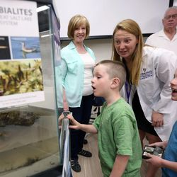 Carter and Caleb Dursteler check out a living rock with geoscience professor Carie Frantz during the grand opening of the new Tracy Hall Science Center at Weber State University in Ogden on Wednesday, Aug. 24, 2016.