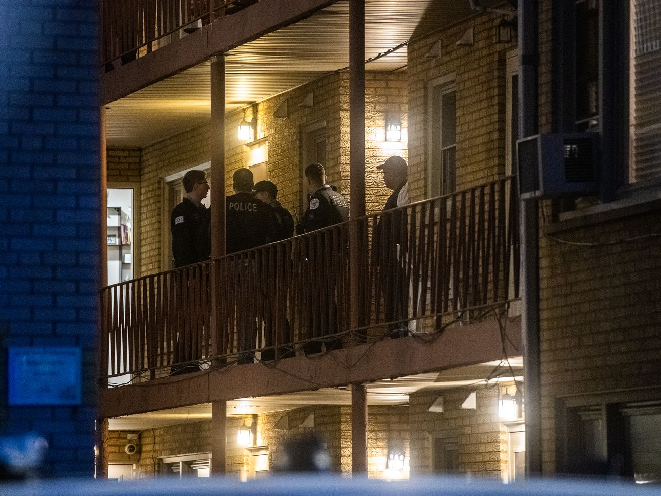 Chicago police investigate a shooting that left four people dead and a fifth critically wounded Saturday, Oct. 12, 2019 at a condo complex in the 6700 block of West Irving Park Road.