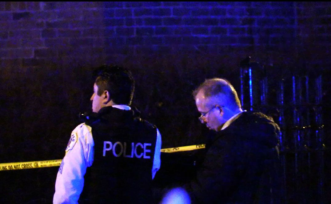 Officers respond to a fatal shooting Friday night in the Hyde Park neighborhood.   Justin Jackosn/Sun-Times