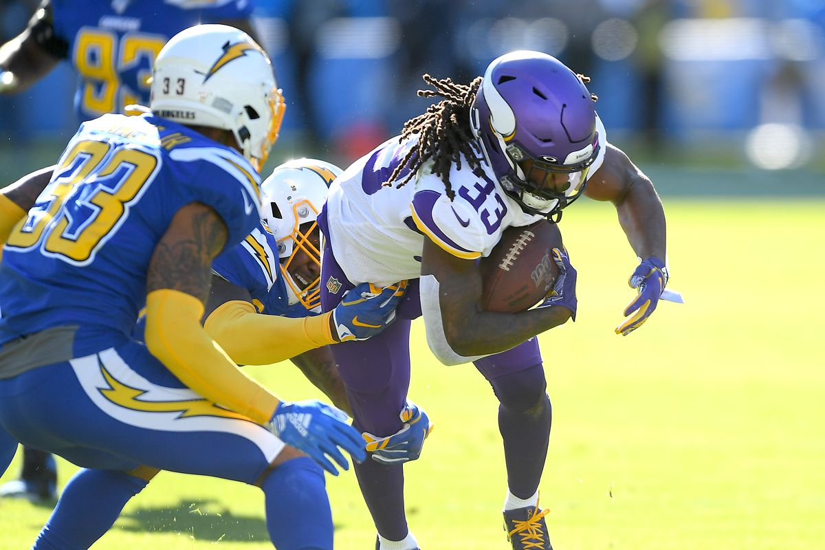 Running back Dalvin Cook of the Minnesota Vikings runs the ball in the first half of the game against the Los Angeles Chargers at Dignity Health Sports Park on December 15, 2019 in Carson, California.
