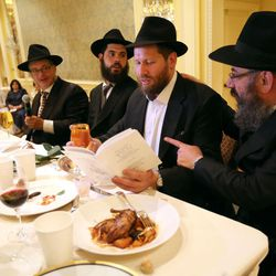 Rabbi Avraham Cohen, Rabbi Mendy Cohen, Israel Schochet, and Rabbi Benny Zippel say grace after meals during Chaya Zippel and Rabbi Mendy Cohen's traditional Hasidic wedding at the Grand America Hotel in Salt Lake City on Monday, Sept. 12, 2016.