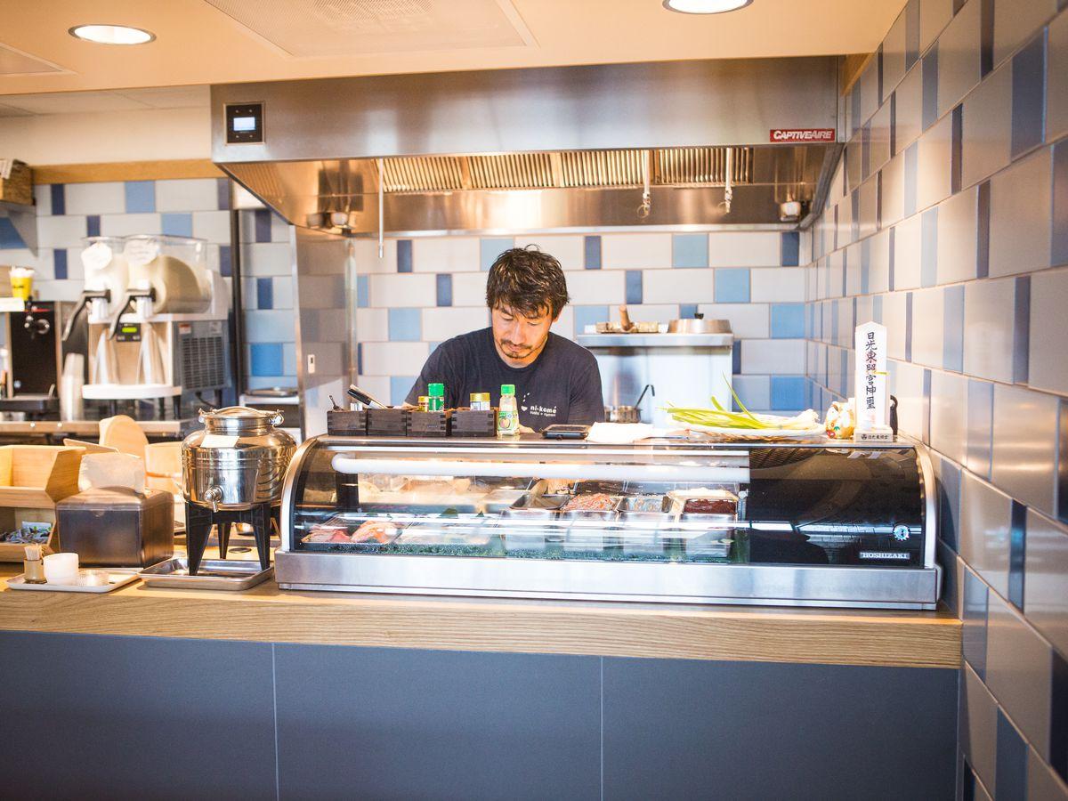 Takehiro Asazu behind the sushi counter at Uroko
