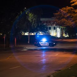 A Kenosha Police Department squad car sits alone on a downtown street after curfew on the fourth day of civil unrest after police shot Jacob Blake, Wednesday night, Aug. 26, 2020.