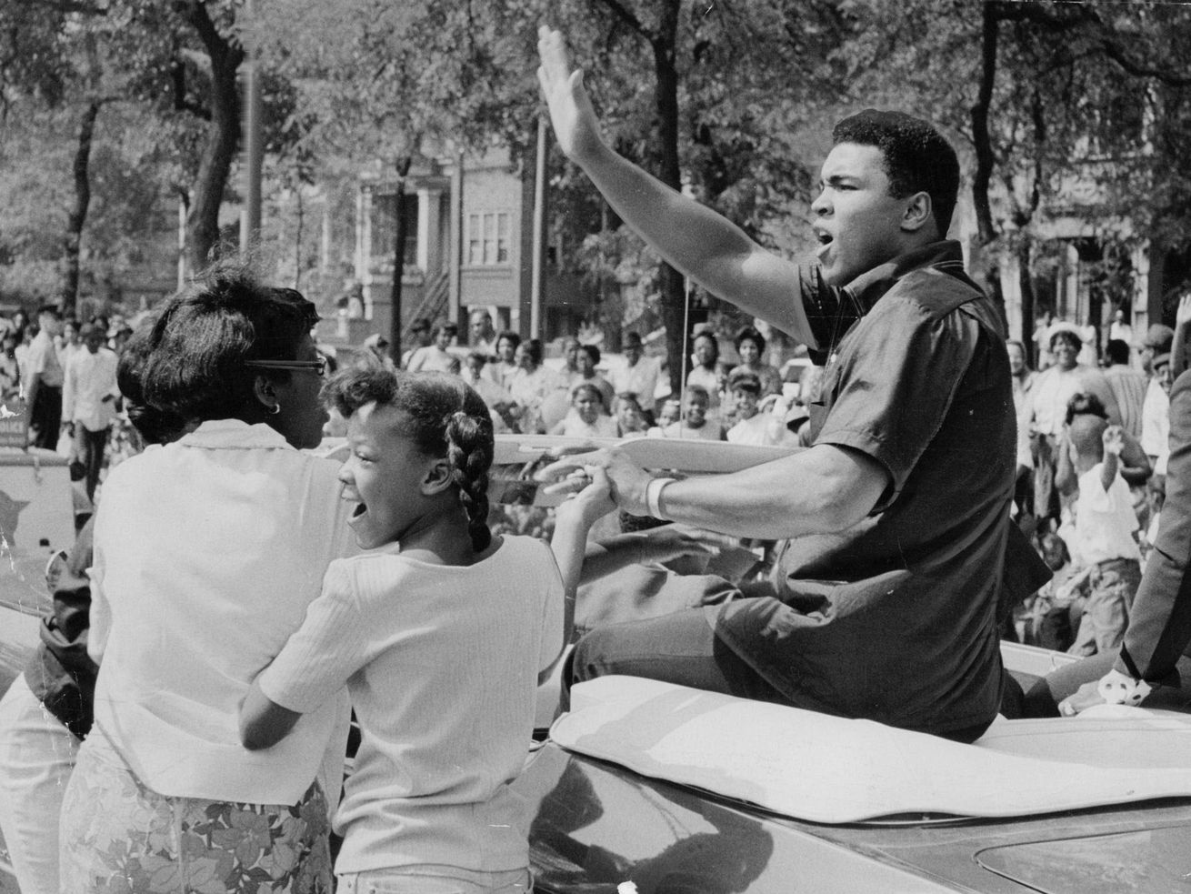 Muhammad Ali rode in the Bud Billiken Parade on the South Side in 1966,