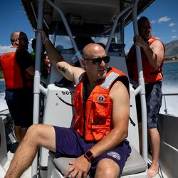 Jason Campos, a Weber Fire District firefighter and advanced emergency medical technician, center, rides on a Weber County Sheriff's Office boat while the two agencies practice water rescue training at Pineview Reservoir near Huntsville, Weber County, on Monday, June 28, 2021.