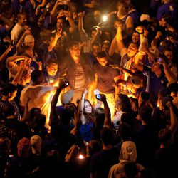 Kentucky fans burn furniture and dance in the middle of State Street as they celebrate Kentucky's 69-61 win over Louisville in an NCAA Final Four semifinal college basketball tournament game, Saturday, March 31, 2012, in Lexington, Ky.