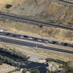 Traffic is stopped on I-84 due to a wildfire at the mouth of Weber Canyon on Tuesday, Sept. 5, 2017.