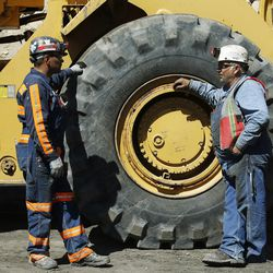 Luis Ortega and Blaine Fillmore talk near a loader at the Bronco Utah Mine near Emery on Wednesday, March 29, 2017.