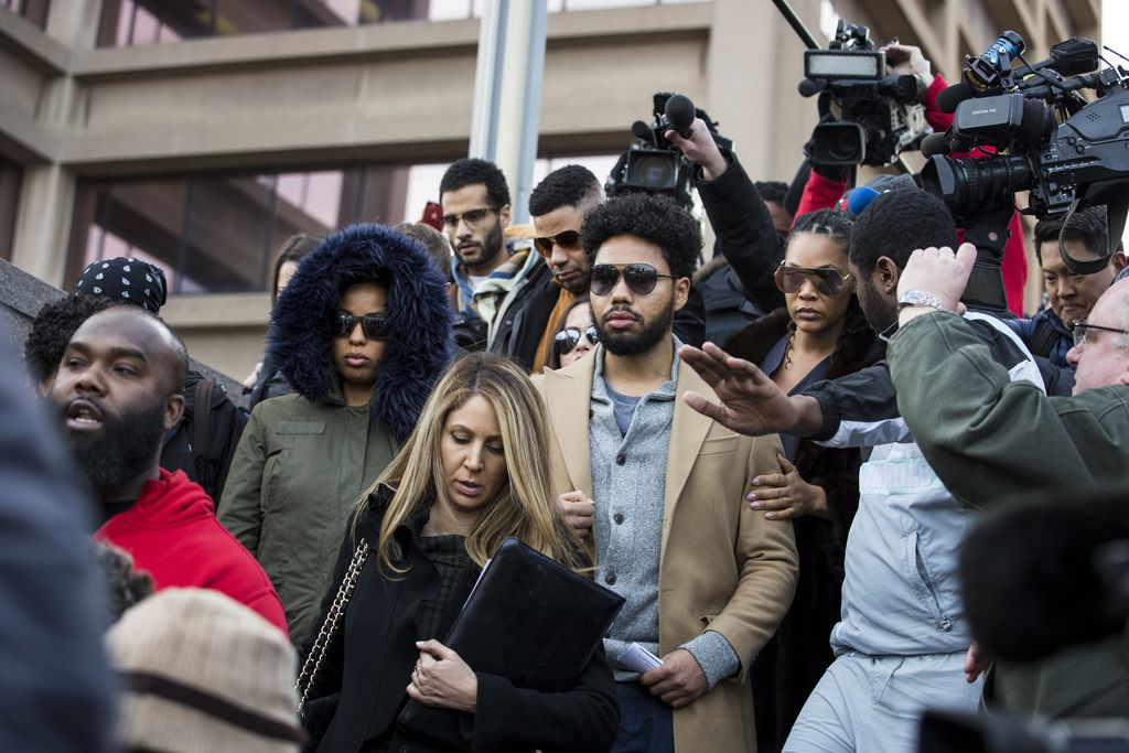 Jussie Smollett's family leaves the Leighton Criminal Courthouse among a gaggle of reporters and photographers after the actor was ordered held on $100,000 bail on charges of felony disorderly conduct Thursday, Feb. 21, 2019. | Ashlee Rezin/Sun-Times