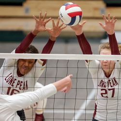 Lone Peak's Annie Taylor and Kinley Swan fend off a hit from Fremont's Maggie Mendelson, left, in a 6A volleyball state semifinals game at Hillcrest High School in Midvale on Friday, Nov. 6, 2020.