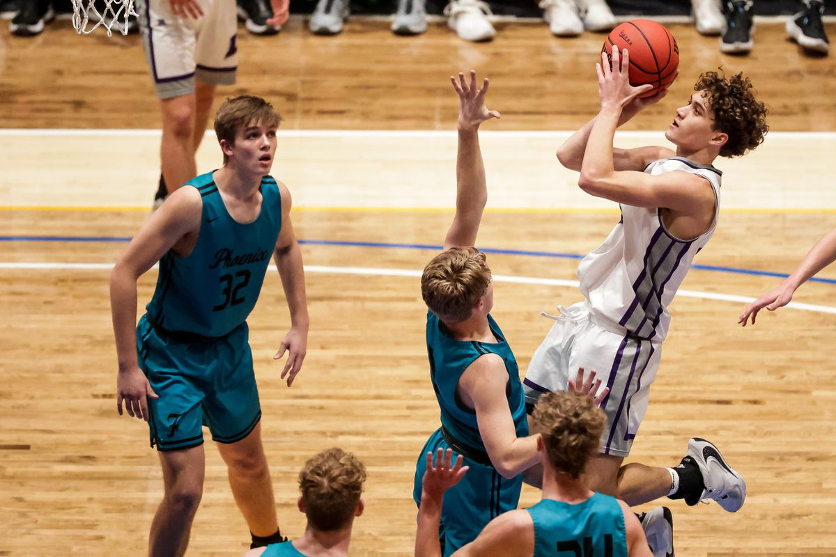 Lehi's Noa Gonsalves shoots over Farmington players in the 5A boys basketball championship at Salt Lake Community College in Taylorsville on Saturday, March 6, 2021.