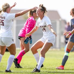 Lone Peak's Lacy Fox and Kate Denney celebrate after Denney scored on Skyridge in a girls soccer game in Lehi on Thursday, Sept. 9, 2021.