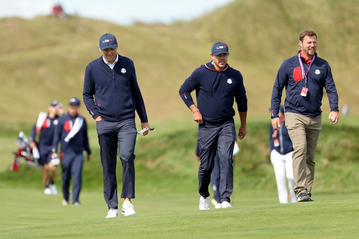 Scottie Scheffler of team United States and Brooks Koepka of team United States walk during a practice round prior to the 43rd Ryder Cup at Whistling Straits on September 22, 2021 in Kohler, Wisconsin.