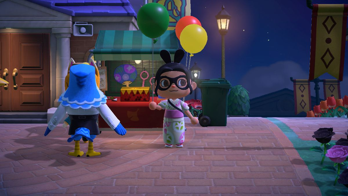 An Animal Crossing character holds a Green Balloon