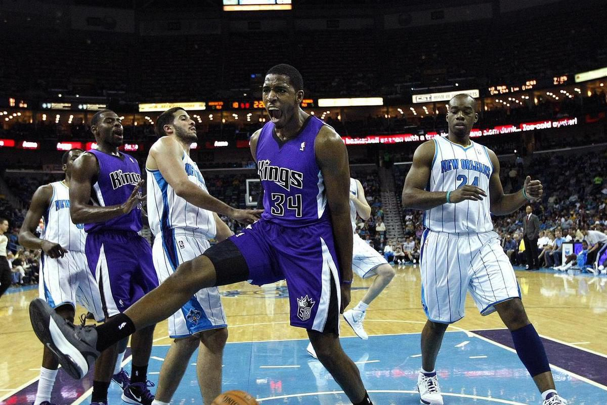 Sacramento Kings center Jason Thompson (34) reacts after slam-dunking over New Orleans Hornets power forward Carl Landry (24) and point guard Greivis Vasquez, left, in the first half of an NBA basketball game in New Orleans, Wednesday, April 11, 2012.