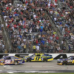 The green flags drops for lead drivers Martin Truex Jr. (56), Matt Kenseth (17), Greg Biffle (16) and Mark Martin (55) to start the NASCAR Sprint Cup Series auto race at Texas Motor Speedway Saturday, April 14, 2012, in Fort Worth, Texas.