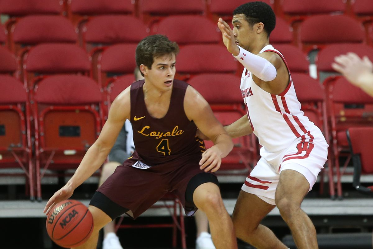Loyola Ramblers guard Braden Norris works the ball against Wisconsin Badgers guard D'Mitrik Trice during the second half at the Kohl Center.