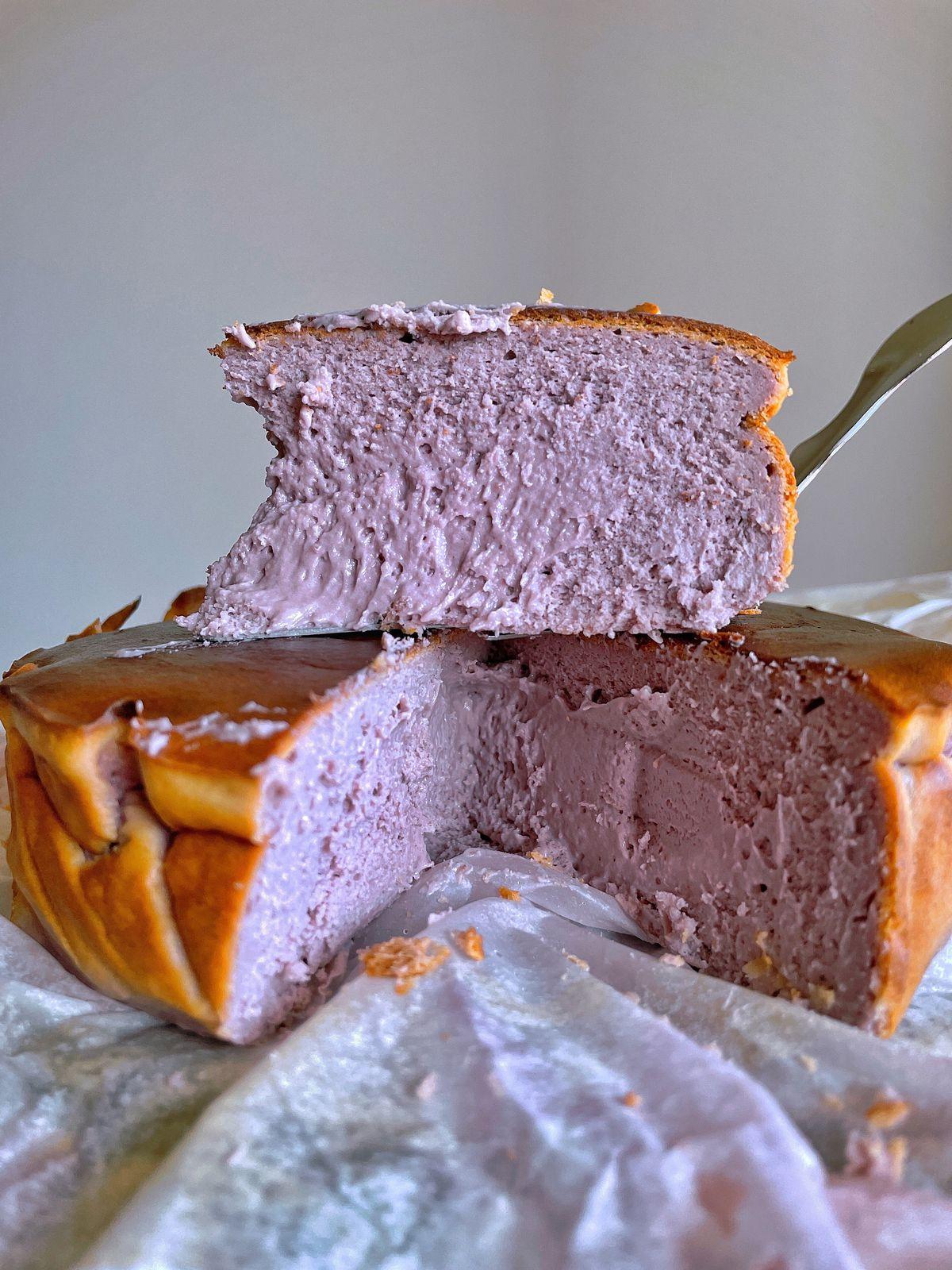 a slice of purple cheesecake.