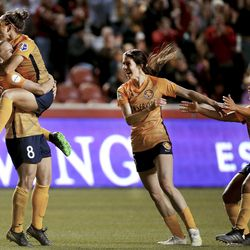 Utah Royals FC forward Amy Rodriguez (8) is congratulated by teammates Vero Boquete, Erika Tymrak and Desiree Scott after scoring against Chicago at Rio Tinto Stadium in Sandy on Friday, May 3, 2019.