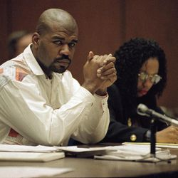 FILE - This Feb. 4, 1993 file photo shows Henry Watson, one of three men accused of beating truck driver Reginald Denny, during his trial in a Los Angeles courtroom. At right is his lawyer Karen Ackerson. The acquittal of four police officers in the videotaped beating of Rodney King sparked rioting that spread across the city and into neighboring suburbs. Cars were demolished and homes and businesses were burned. Before order was restored, 55 people were dead, 2,300 injured and more than 1,500 buildings were damaged or destroyed.(