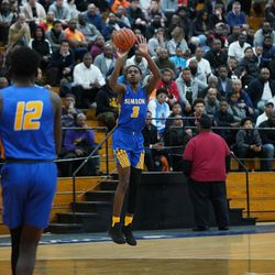 Simeon's Antonio Reeves (3) pulls up a jump shot against Young, Wednesday 02-13-19. Worsom Robinson/For the Sun-Times.