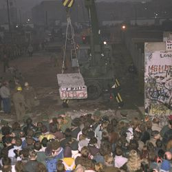 A crowd of West Berliners gathers on the western side of the Berlin Wall at Potsdamer Platz to watch East German workers pull down segments of the barrier early Sunday, November 12, 1989.  The East Germans worked throughout the night creating the new East-West passage to help accommodate the hundreds of thousands of East German citizens who have been arriving in the West since their government lifted travel restrictions Thursday.