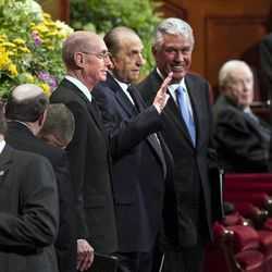 The First Presidency walks onto the stand for the afternoon session Saturday, April 6, 2013 of the 183th Annual General Conference of The Church of Jesus Christ of Latter-day Saints in the Conference Center.