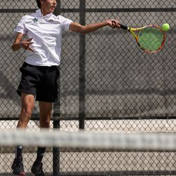 Rowland Hall's Jaiden Handlon plays against Waterford's Lalith Suresh in the 3A boys tennis No. 1 singles championship match at Liberty Park in Salt Lake City on Saturday, May 22, 2021.