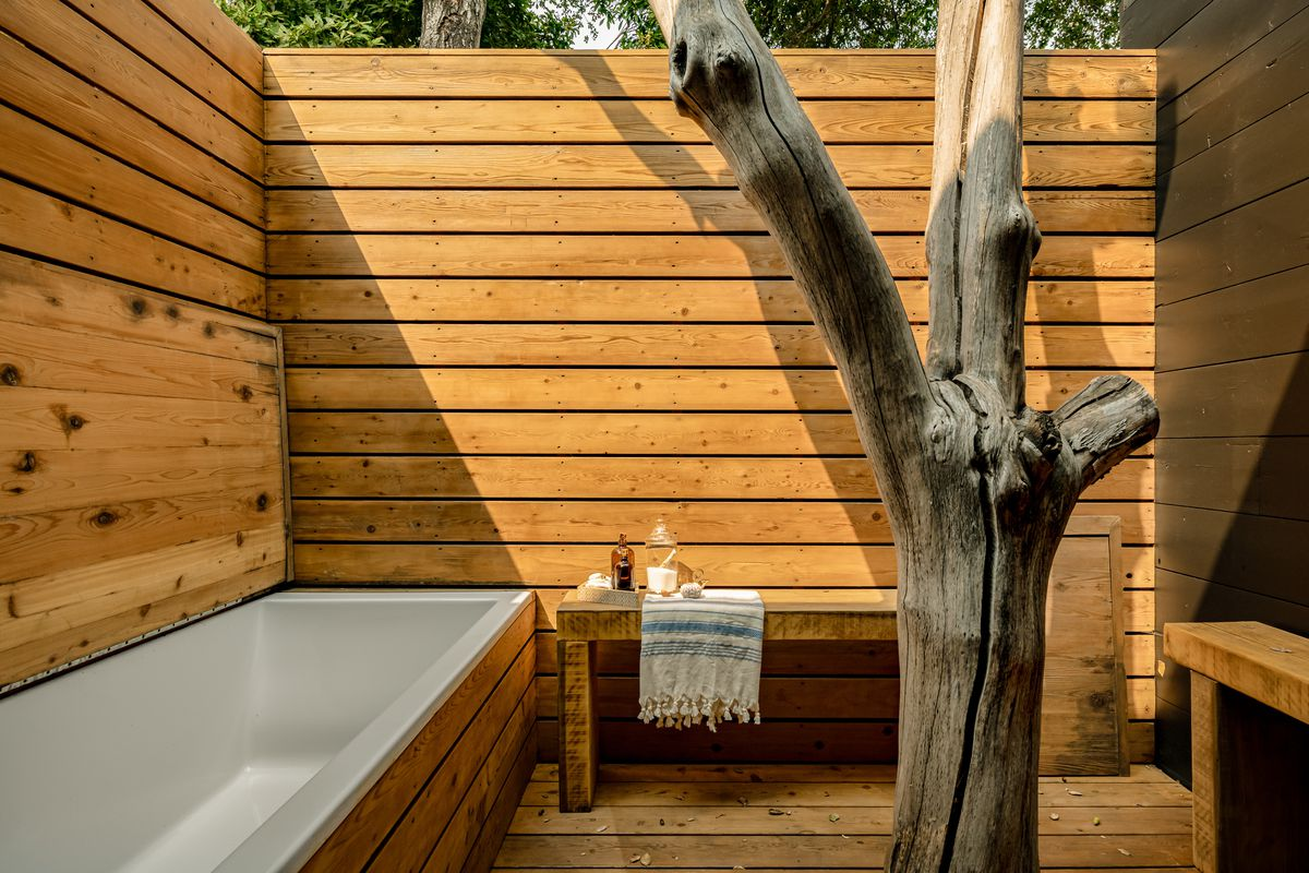 Tub wrapped in wood.